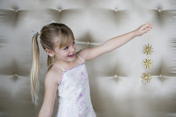 Little girl holding a Christmas decoration