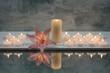 Rosa Lilienblüte mit Kerzen