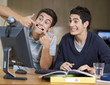 Two teenage boys studying using a computer