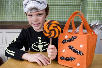 Little boy with trick or treat sweets