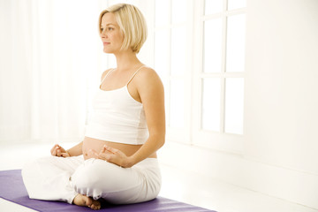 A pregnant woman practicing yoga