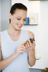 Woman choosing perfume in a store