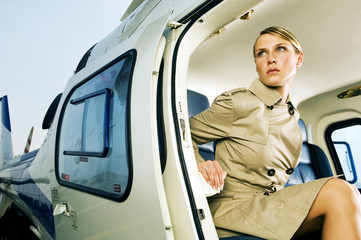 A woman sitting in a helicopter
