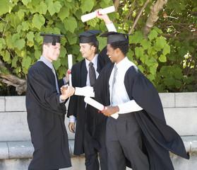 Three graduates celebrating