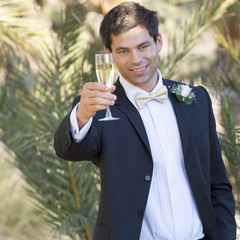 A groom offering a toast