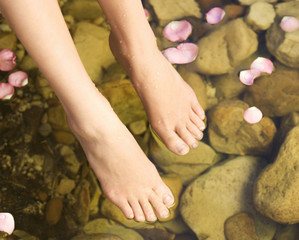 Close-up of feet in a natural pool