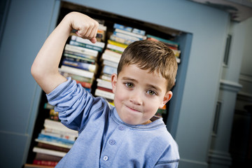 little boy showing off his muscles