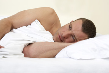 Young man laying in bed