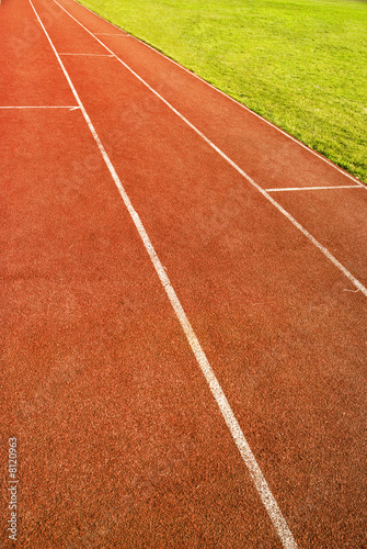 green grass and running track
