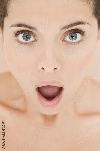 Portrait of young woman with mouth open in shock