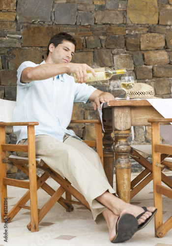 A man pouring a glass of wine