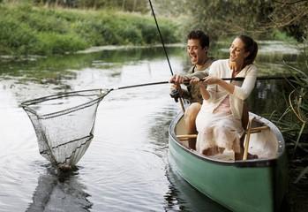 Young couple fishing