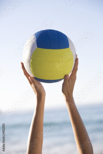 A woman catching a ball