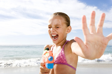 A young girl playing on the beach