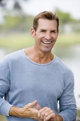 portrait mid adult man in blue sweater