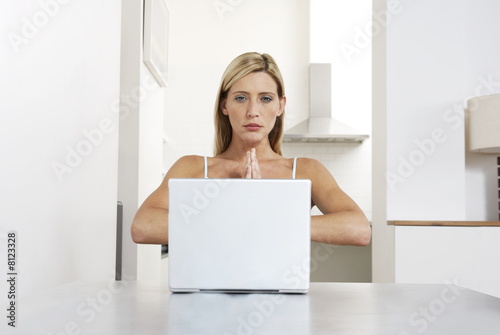 Young woman practicing yoga while working from home