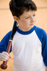 Boy with baseball bat over his shoulder