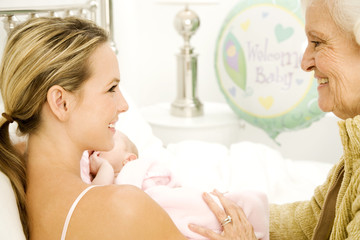 A grandmother greeting her new grandchild after the birth
