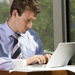A businessman working on a laptop computer