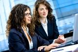 Businesswomen working on computer poster