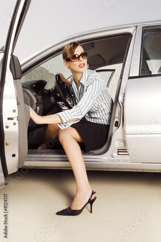 A businesswoman getting out of a car