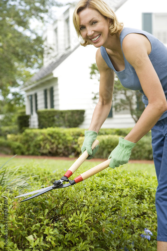 woman pruning with garden shears