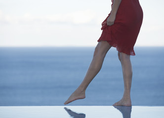 A woman standing on the edge of a pool