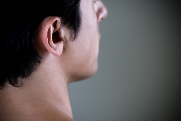 Close up portrait of a young man's ear