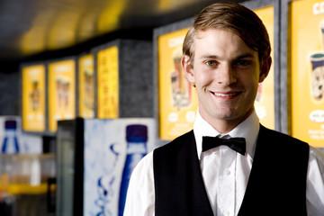 Smartly dressed usher at the cinema