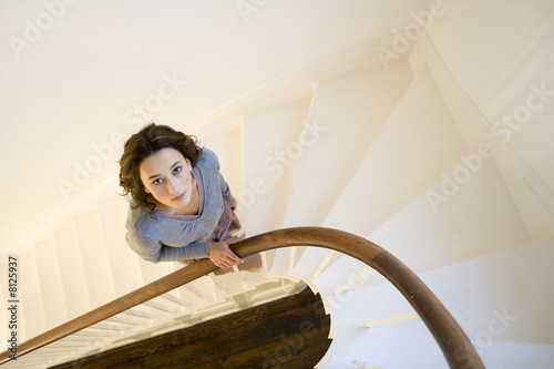 A young woman walking up stairs