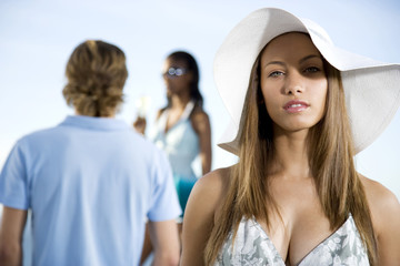 Young woman in a floppy hat