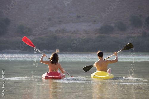 A couple canoeing on a lake