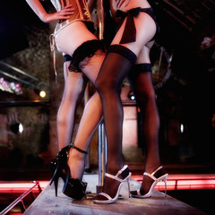 Two pole dancers at a nightclub