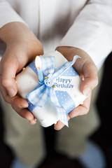close up shot hands holding miniature birthday cake