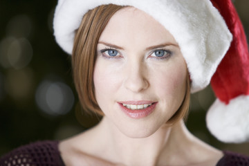Portrait of a woman wearing Santa's hat