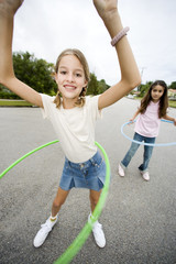 Two young girls with hoops