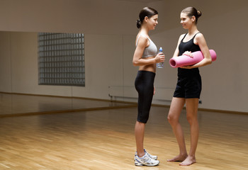 Two young women in a gym