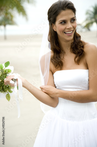 A bride standing on a beach