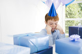 boy looking sad at birthday party