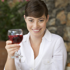 A woman enjoying a glass of wine