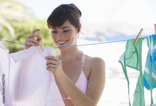 A woman hanging washing out to dry