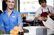 Portrait of  supermarket checkout assistants.