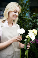 Woman florist or gardener holding some white flowers