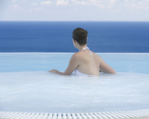 A woman relaxing in a jacuzzi