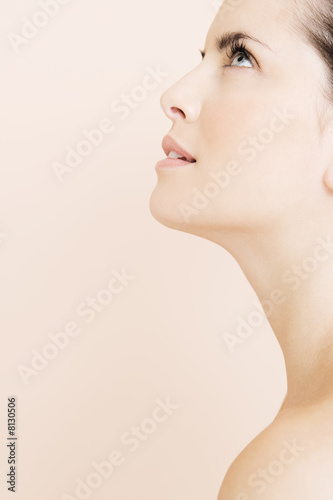 Profile of young woman looking upwards