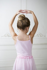 Young girl performing a ballet move