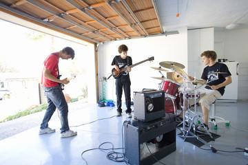 Three teenage boys (16-18) in garage band