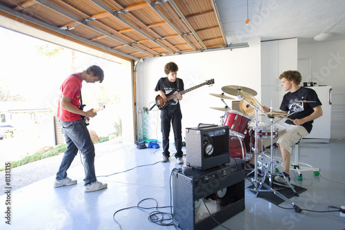 Three teenage boys (16-18) in garage band