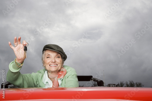 Portrait of a senior woman in a convertible car