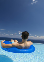 A man relaxing in a pool